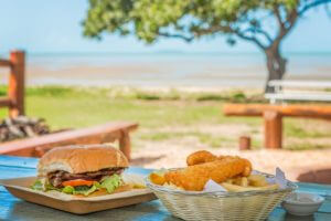 House made lunch at BarraCrab Caravan Park. Beachfront dining.