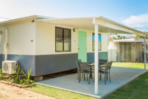 Outdoor dining at a BarraCrab Caravan Park bungalow